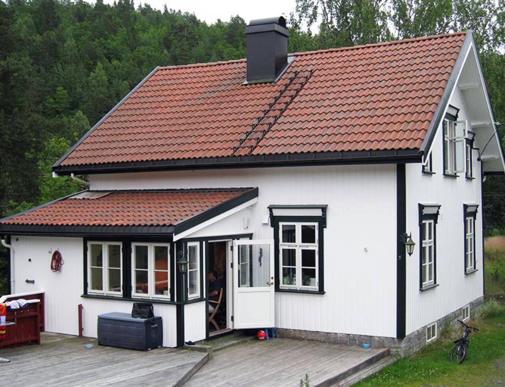 Moderne tilbygg til tradisjonelt hus i Tvedestrand